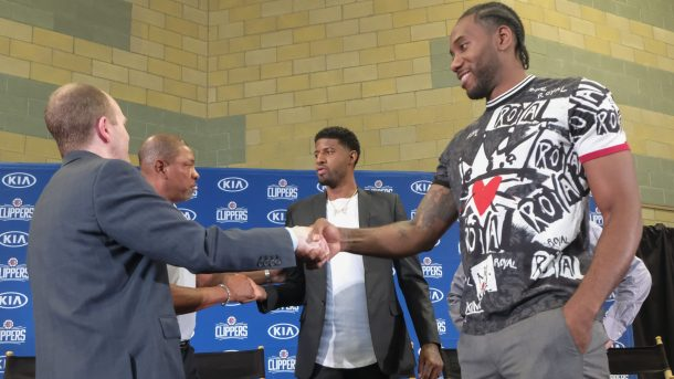 Clippers executive Lawrence Frank with Kawhi Leonard and Paul George