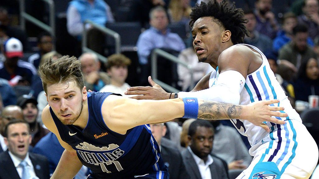 Mavericks star Luka Doncic and Hornets guard Devonte' Graham