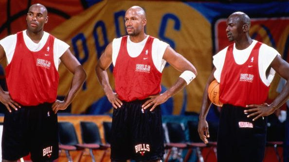 Scott Burrell, Ron Harper and Michael Jordan of the Chicago Bulls