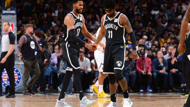 Nets guards Garrett Temple and Kyrie Irving