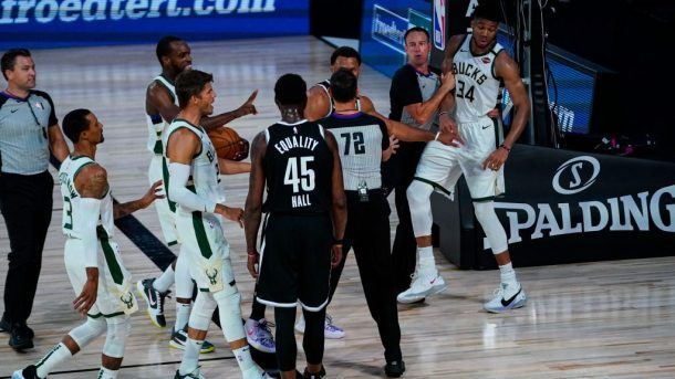 Bucks star Giannis Antetokounmpo and Nets big Donta Hall