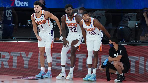 Suns players Devin Booker, Deandre Ayton and Mikal Bridges