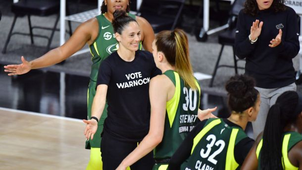 Sue Bird wears shirt supporting Raphael Warnock in senate race against Kelly Loeffler