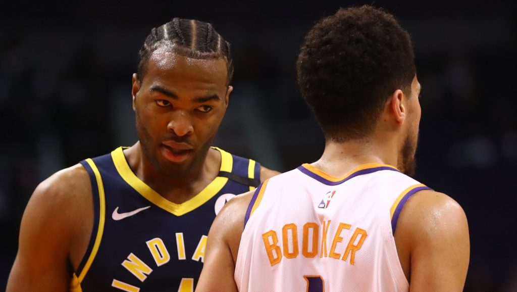 Pacers forward T.J. Warren and Suns guard Devin Booker