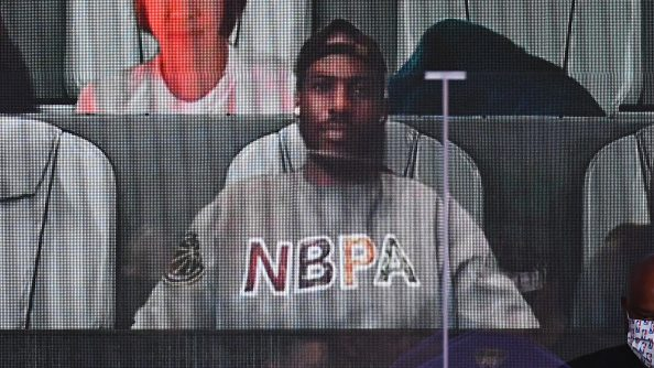 Thunder guard Chris Paul watches Heat-Lakers Game 3 of NBA Finals