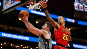Nets guard Joe Harris and Hawks big John Collins