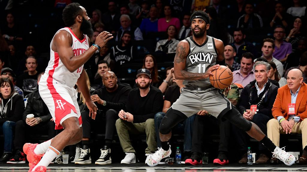 Nets star Kyrie Irving and James Harden with Rockets