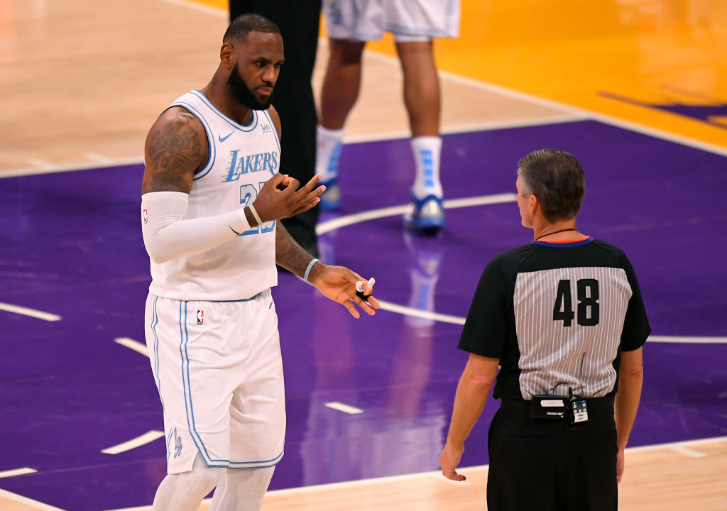 Lakers star LeBron James and NBA referee Scott Foster