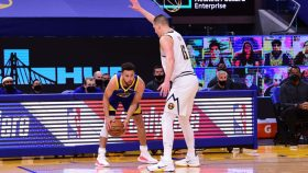 Warriors guard Stephen Curry and Nuggets center Nikola Jokic