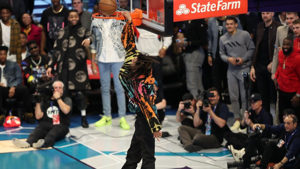 Rapper J Cole tries to dunk during dunk contest