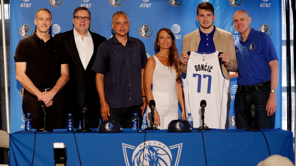 Donnie Nelson, Luka Doncic and his mother along with Dallas Mavericks Head Coach Rick Carlisle