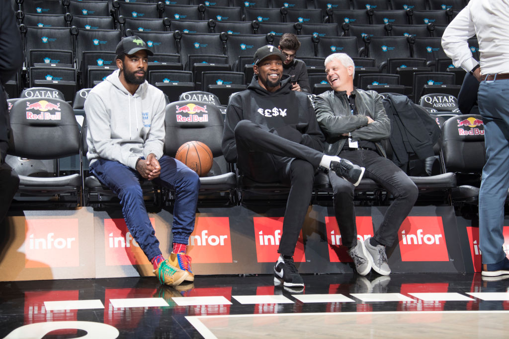 Kyrie Irving, Kevin Durant and Nets president David Levy
