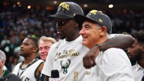 Bucks guard Jrue Holiday and Bucks owner Marc Lasry, who will pay the luxury tax