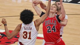 Lauri Markkanen #24 of the Chicago Bulls battles for a rebound with Jarrett Allen #31 and Larry Nance Jr. #22 of the Cleveland Cavaliers