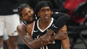 Terance Mann and Paul George in Utah Jazz v Los Angeles Clippers - Game Six